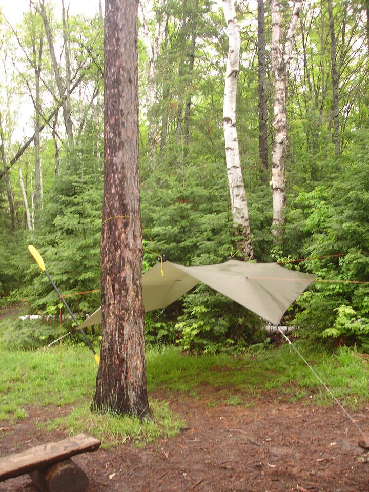 8 a.m. Taking down the tarp last, before heading back to Canoe Lake.  A few minutes later, while loading the canoe, I fell into the lake, along with the camera...so no more pics after this point. Got windbound part of the day. Back to Toronto at 11p.m. Sunday night. Long day but fun.