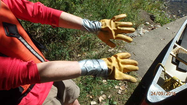 Experienced river cleaners know how to keep water out of their work gloves