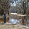 Hilde observes the flooded road to get to the Murdock McRae's Landing put-in<br /> on the flooded Ocmulgee River.<br /> February 21, 2013