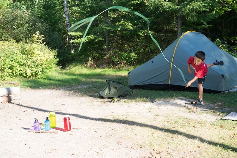 Lassoing water bottles with a new rope that we acquired at this campsite, because what could be more fun than that!