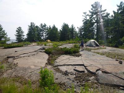 D4 D wood gathering near tents