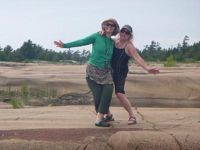 D4 J&J posing on smooth rocks