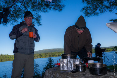 Cooking alfresco - Temagami Ontario -- day 4 we woke to frost --.note the toque!