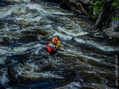 Barrelling down river
