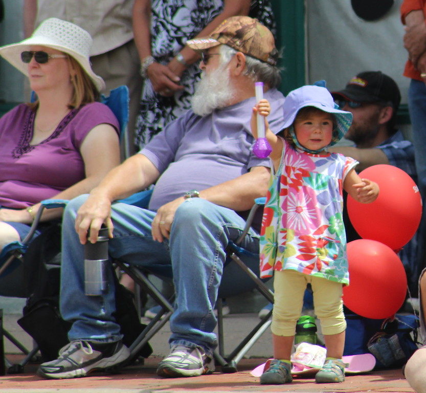. A small member of the crowd watches Saturday as the 2017 Blossom Festival Parade goes by.
