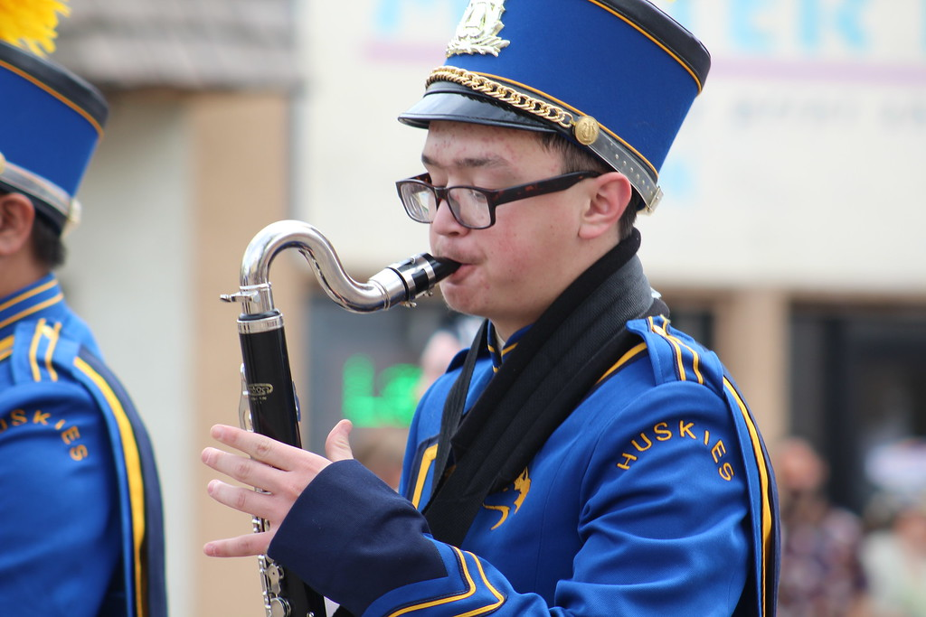 . A Florence High School marching band member walks along Saturday through the 2017 Blossom Festival Parade.