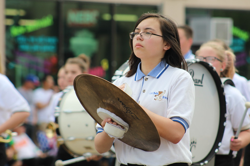 . A Cañon City Middle School marching band member walks along Saturday through the 2017 Blossom Festival Parade.