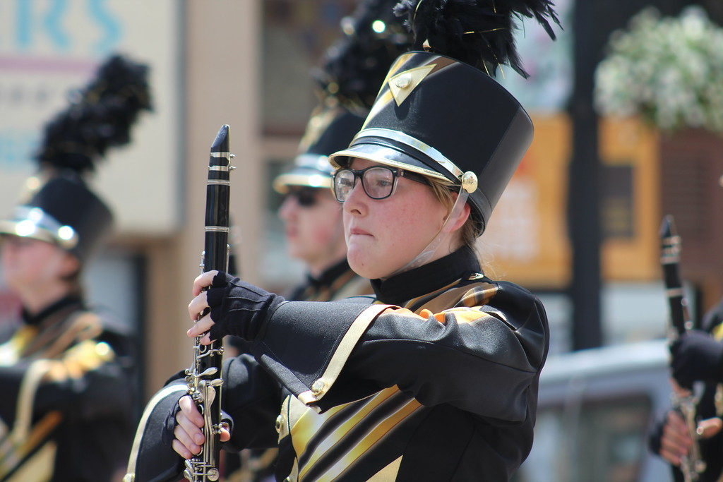 . A member of Cañon City High School\'s marching band walks through the 2017 Music and Blossom Parade Saturday.