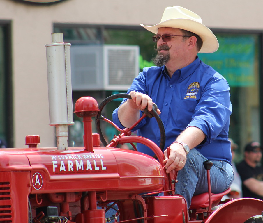 . Colorado Senate President Kevin Grantham rides along Saturday through the 2017 Blossom Festival Parade.