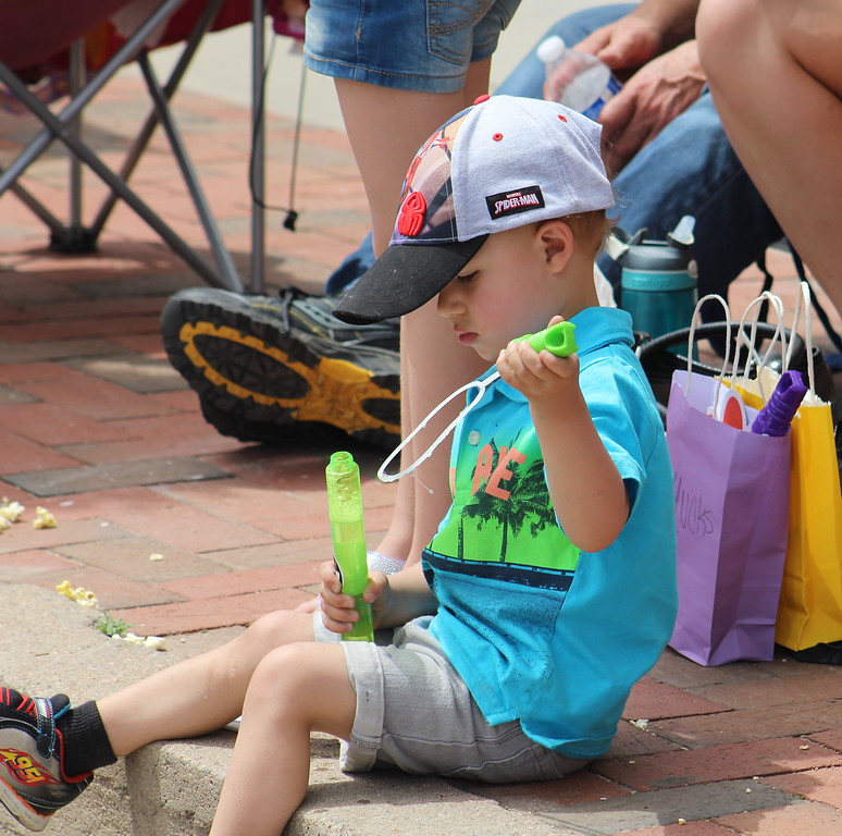 . A parade goer prepares bubbles Saturday through the 2017 Blossom Festival Parade.