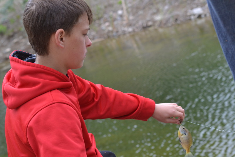 Conner McCall, 12, catches a fish during the annual Kids Fishing Derby on Saturday at Pathfinder Park Pond, sponsored by the Canon City Area Recreation and Parks District and Colorado Parks and Wildlife. Carie Canterbury/Daily Record 5-14-16