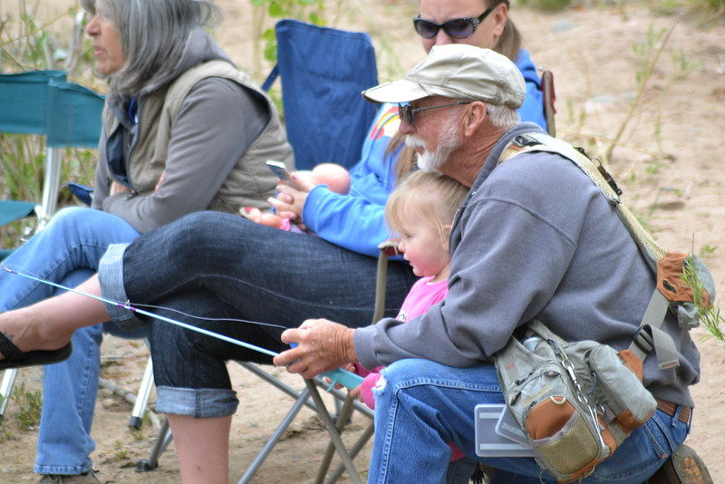 Ed Henderson fishes with his granddaughter, Madison Henderson, 2, during the annual Kids Fishing Derby on Saturday at Pathfinder Park Pond, sponsored by the Canon City Area Recreation and Parks District and Colorado Parks and Wildlife. Carie Canterbury/Daily Record 5-14-16
