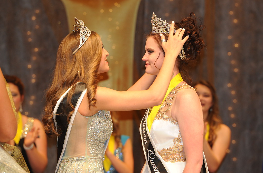 . Raina Snelson, 2015 Canon City Music & Blossom Festival Queen, crowns Courtney Crossman, the 2016 Blossoml Queen, during the 71st annual pageant Saturday at Canon City high School.  Carie Canterbury/Daily Record 3-19-16