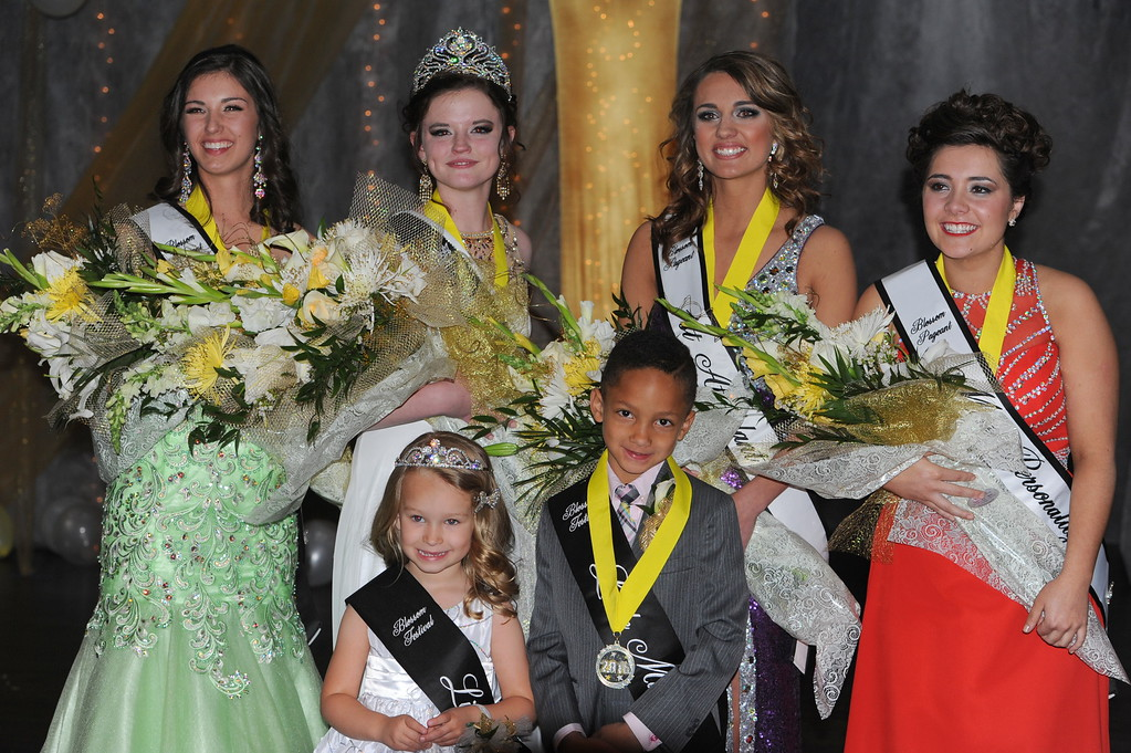 . The 2016 Canon City Music & Blossom Festival Queen\'s court, pictured from left to right: Alessandra Giammo, 2nd attendant; Courtney Crossman, queen; Jordyn  Whitney, 1st attendant; Ceianna Higgins, Miss Personality; front row: Tayah Salazar, Little Miss, and Kayden Fields, Little Mister. Carie Canterbury/Daily Record 3-19-16