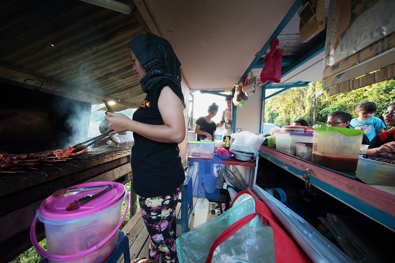 "roadside hawker at the foot of Bukit Pala in the remote village of Mulu, Sarawak.<br><span style=""font-size:75%"">©Yangchen Lin</span>"