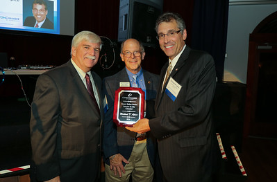 Michael D'Apice, right was honored with the Henry Bahre Service to the Chamber award. From left are Chuck Joseph Jr., outgoing president, Gary Miller, Executive Director and D'Apice.  Photo by John Fitts