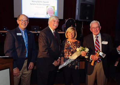 Phil Worley, left was honored for his 13 years as the Canton Chamber of Commerce Executive Director and was given the Henry Bahre Service to the Chamber honor. From left are Gary Miller, Chuck Joseph, Kathy Worley and Phil Worley.  Photo by John Fitts