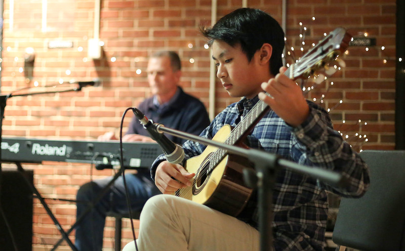 Lang Le aat the Canton Parents for Music Coffee House at CHS on Jan. 6, 2017. In background is Canton Intermediate School sixth-grade teacher Patrick Allen.