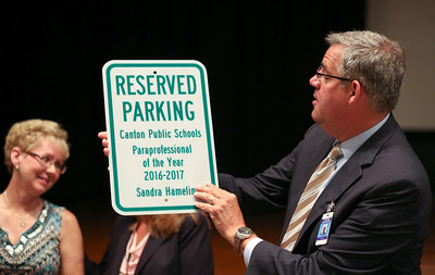 As shown by Superintendent Kevin Case, being named Canton's 2016-2017 paraeducator of the year, does come with its perks.  Photo by John Fitts