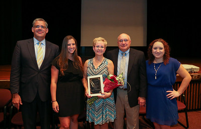 Sandy Hamelin has been named Canton's 2016-2017 paraeducator of the year. Here she is pictured with her family and Superintendent Kevin Case.  Photo by John Fitts