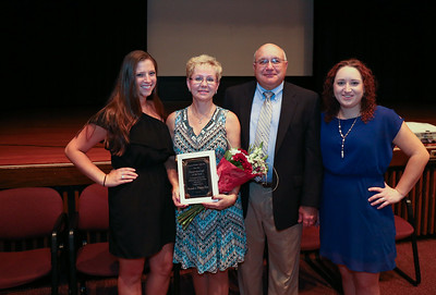 Sandra Hamelin has been named Canton's 2016-2017 paraeducator of the year. Here she is pictured with her family. Photo by John Fitts