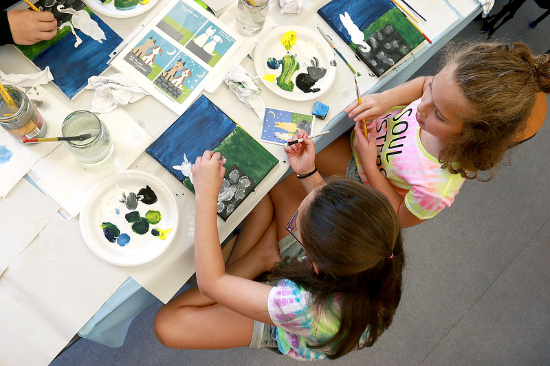 The Leominster Public Library held a canvas painting workshop with local artist Jen Niles on Tuesday, July 25, 2017 in the childrens room at the library. Ava Macone, 9, and her friend Tessa DiVerdi, 9 on right, work on their paintings during the class. SENTINEL & ENTERPRISE/JOHN LOVE