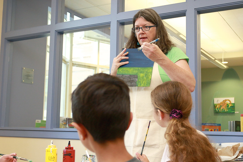 The Leominster Public Library held a canvas painting workshop with local artist Jen Niles on Tuesday, July 25, 2017 in the childrens room at the library. Niles give the class some instruction on how to paint the sky. SENTINEL & ENTERPRISE/JOHN LOVE