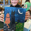 The Leominster Public Library held a canvas painting workshop with local artist Jen Niles on Tuesday, July 25, 2017 in the childrens room at the library. Sadie Michelson, 11, shows off her finished painting. SENTINEL & ENTERPRISE/JOHN LOVE