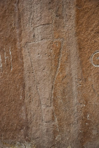 Looks like some sort of Shaman has been carved into the rock.  Of course, some idiots had to fire some bullets at it.