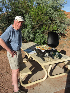 What is Roger cooking on the grill?  Well, it is a Friday evening, which means it is pizza for dinner.