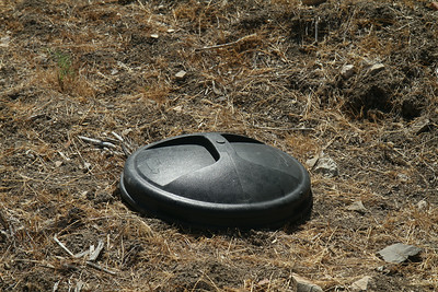 Trash can lid found on upper trail.