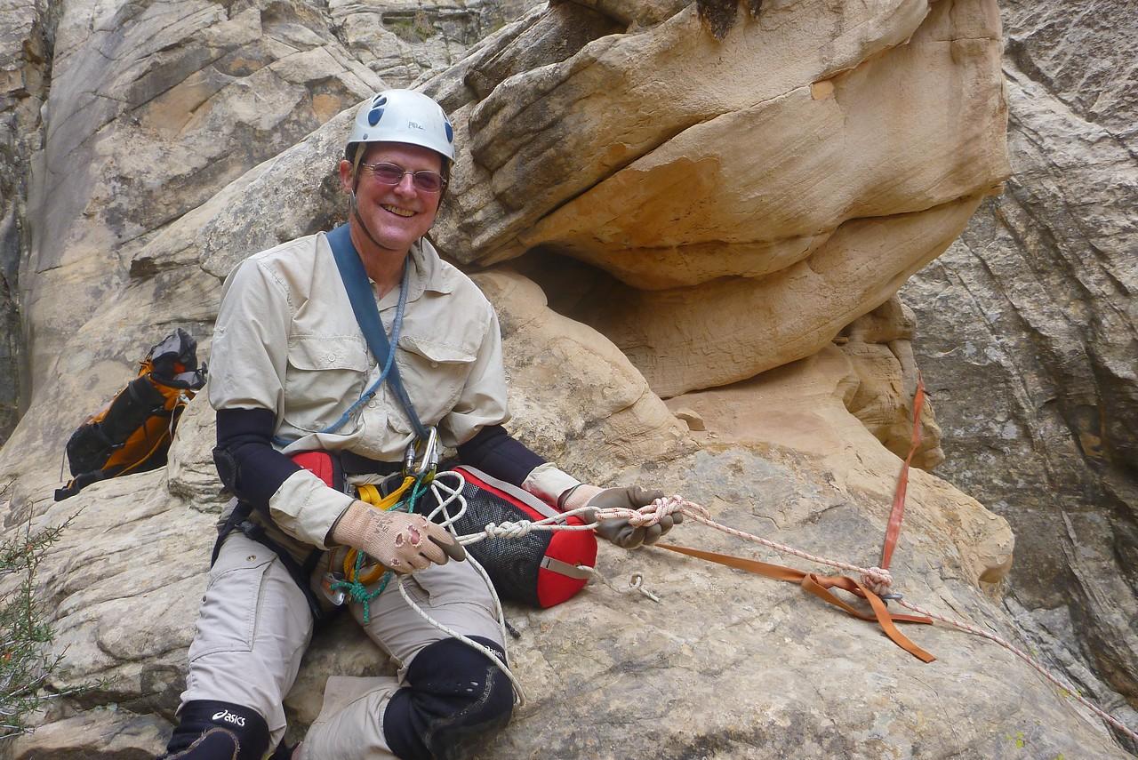 Right Fork Stegosaur Slot canyon descent - Hal setting up the rappel.