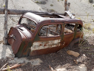 Capitol Gorge hike - Old car at the eastern boundary of the park being used to support a fence.