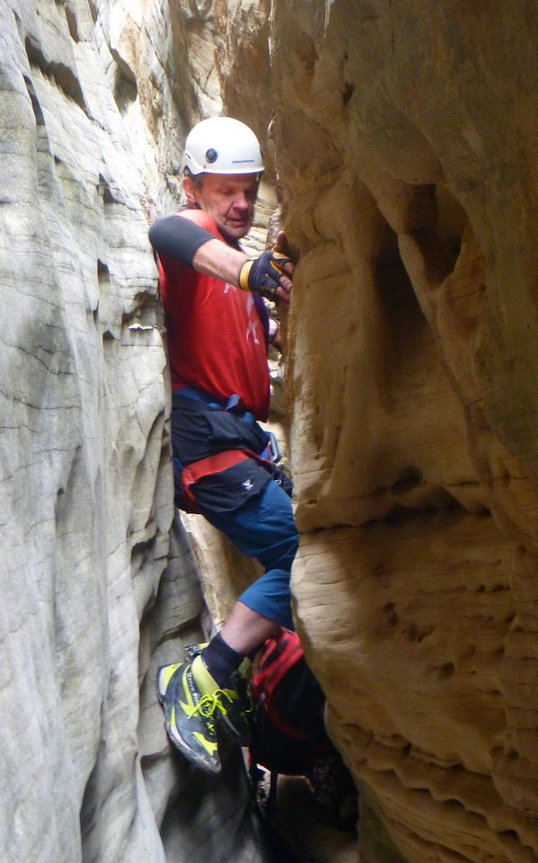 Stegosaur Slot, right fork canyon descent - Dave working hard.