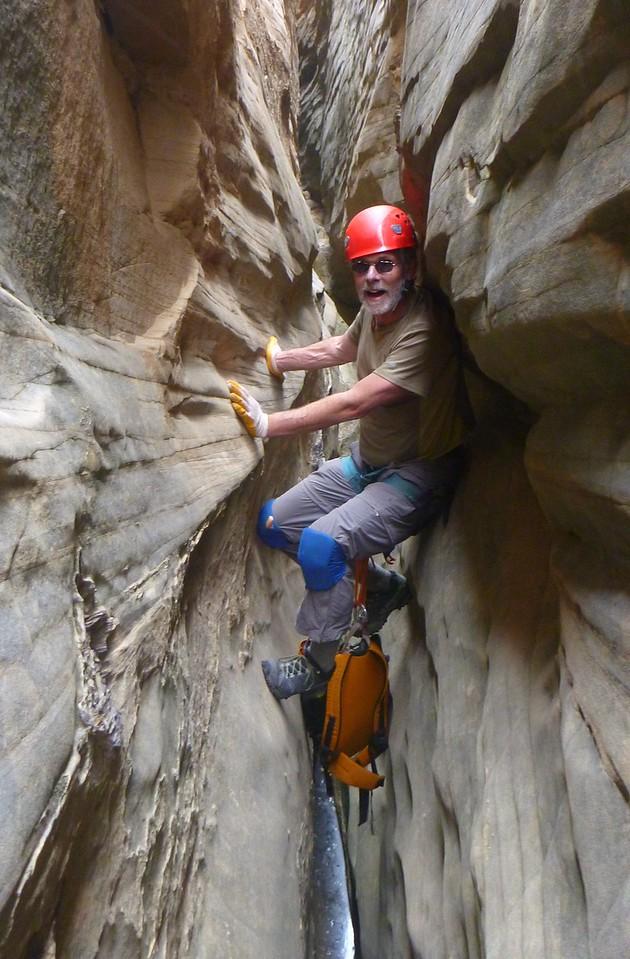 Right Fork Stegosaur Slot canyon descent. Craig staying dry.