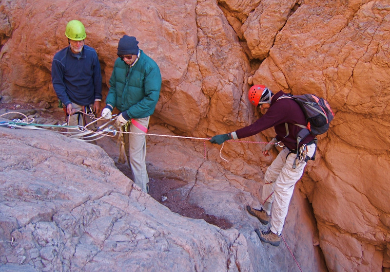 Big rappell in Coffin. Did not have 200-ft rope. Ron H and Ron B lowering Jeff