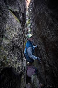 Rachel in the narrow slot, manoeuvering packs