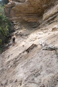 The following morning, Rachel exiting under cliffs