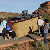 Passengers use their weight to help load the basket onto the truck.  Then we have a champagne breakfast in the beautiful Sedona sunshine.  It's 8:15 AM.
