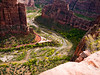 I took this photo lying on my stomach at the top of Angel's Landing -- actually Scout's something.   Anyway, it was really high.  That's a road next to the river, and a double shuttle bus.  What a beautiful place -- I wish you could see it in 3-D.