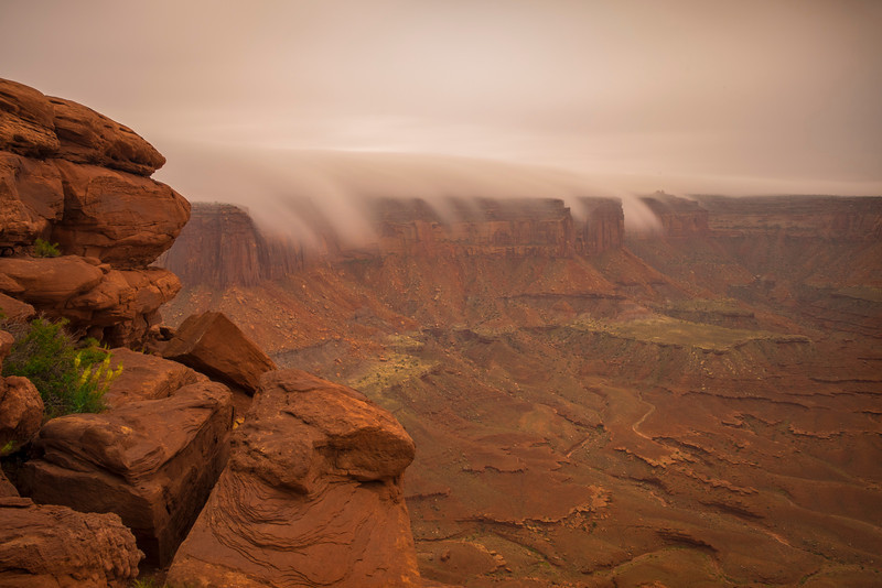 Clouds spill over the east rim, Green River Overlook, Canyonlands N.P.