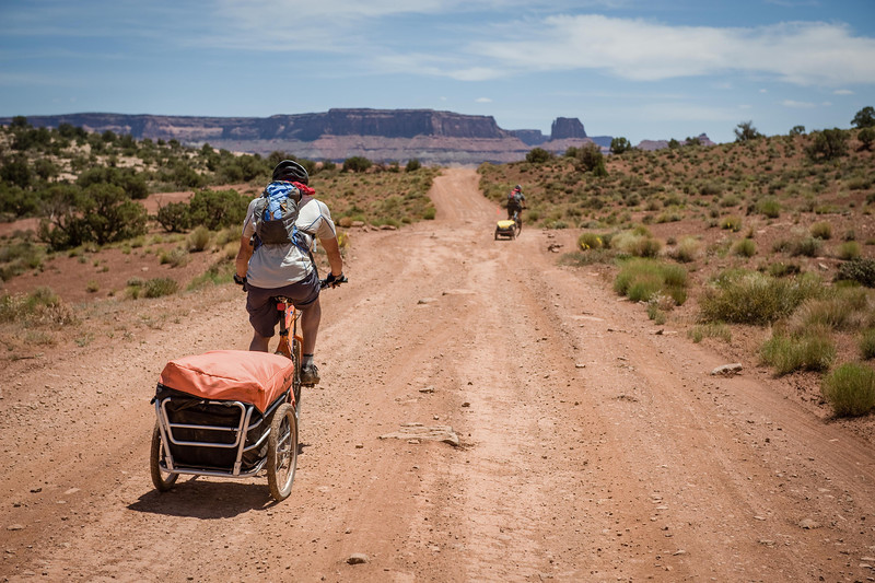 Starting out down the White Rim Trail on a human powered adventure hoping to climb several dessert towers along the way.