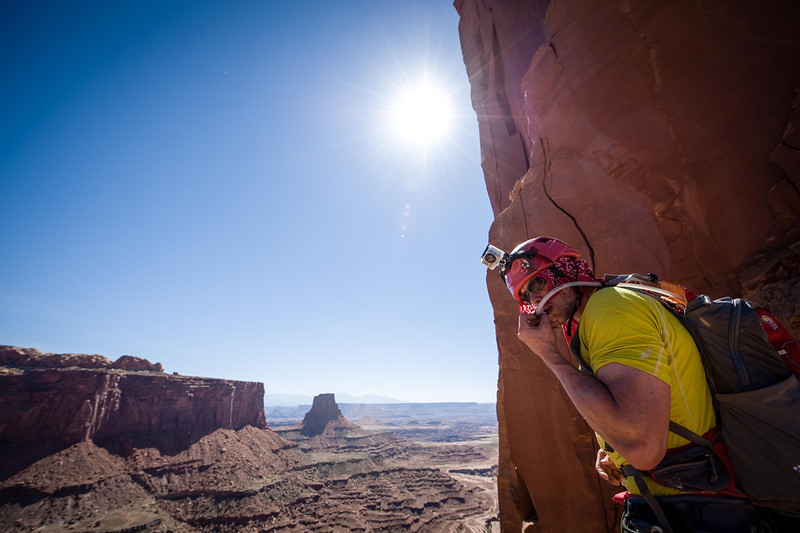 Christian Peterson keeping hydrated while climbing Monster Tower in Canyonlands National Park.