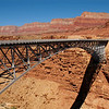 This is the Navajo Bridge which was opened in 1929. It is located in the vicinity of Lees Ferry and it is the worlds highest steel arch bridge. Measured from the middle of the bridge, the Colorado River is 470 feet below at the bottom of Marble Canyon.