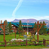 Front view of Glacier Park Lodge. The flower gardens shown here lead to the main entrance of the Lodge.