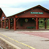 This is the Glacier Park Train Depot. Because the timbers required to build Glacier Park Lodge were larger than those found in Montana's forests, the Great Northern Railway transported the trees to the construction site from Oregon and Washington.