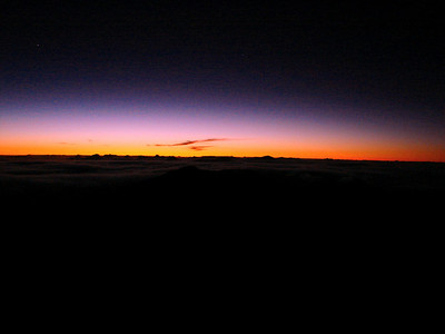 070210: The start of sunrise on Haleakala Crater. This is a view from the summit at 4:38am. If you look closely, you can still see the stars above the aurora. I woke up at 2:00am and began the trek at 2:25am. I was bundled up with thick fleece, winter hat, gloves, backpack, tripod, camera gear, and a Petzl Lamp on my forehead. The temperature was below freezing on the summit at 10,023 feet. Sunrise was due at 5:41am.