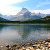 Hiking along Swiftcurrent Lake. Mount Wilbur (9,321') in the background.