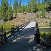 Upper Geyser Basin: A boardwalk that crosses the Firehole River.