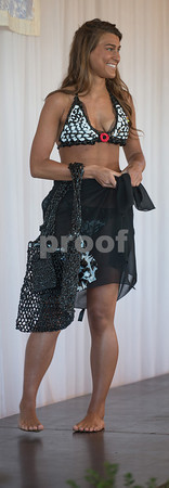 """Desi Smith/Cape Ann<br /> Miss Massachusetts Charlotte Papp models a bikini and bag crotcheted by former fisherman Accursio """"Gus"""" Alba and his wife, Francesca, of Gloucester from plastic grocery bags."""